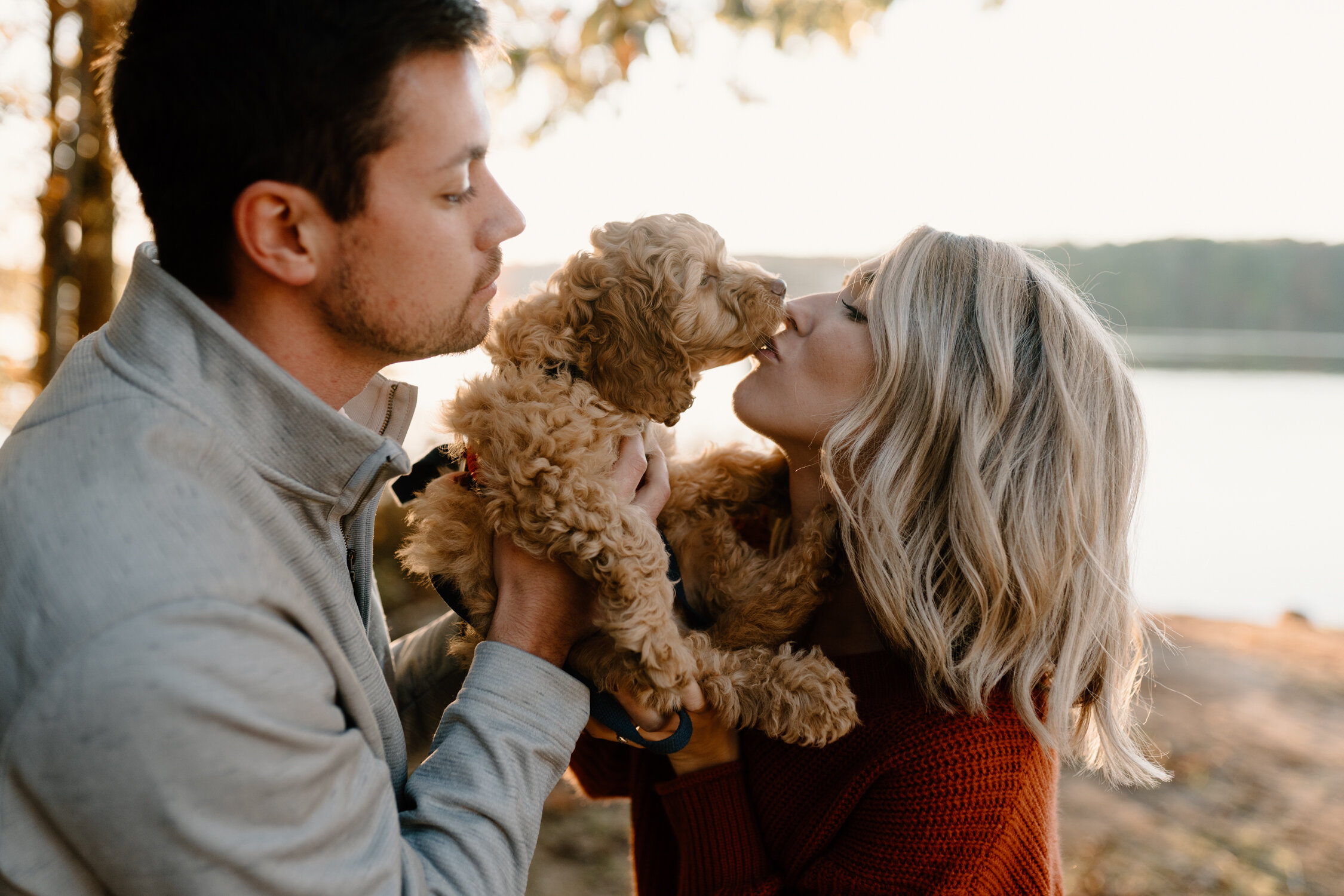 Puppy kisses during fall engagement session at Lake Brandt