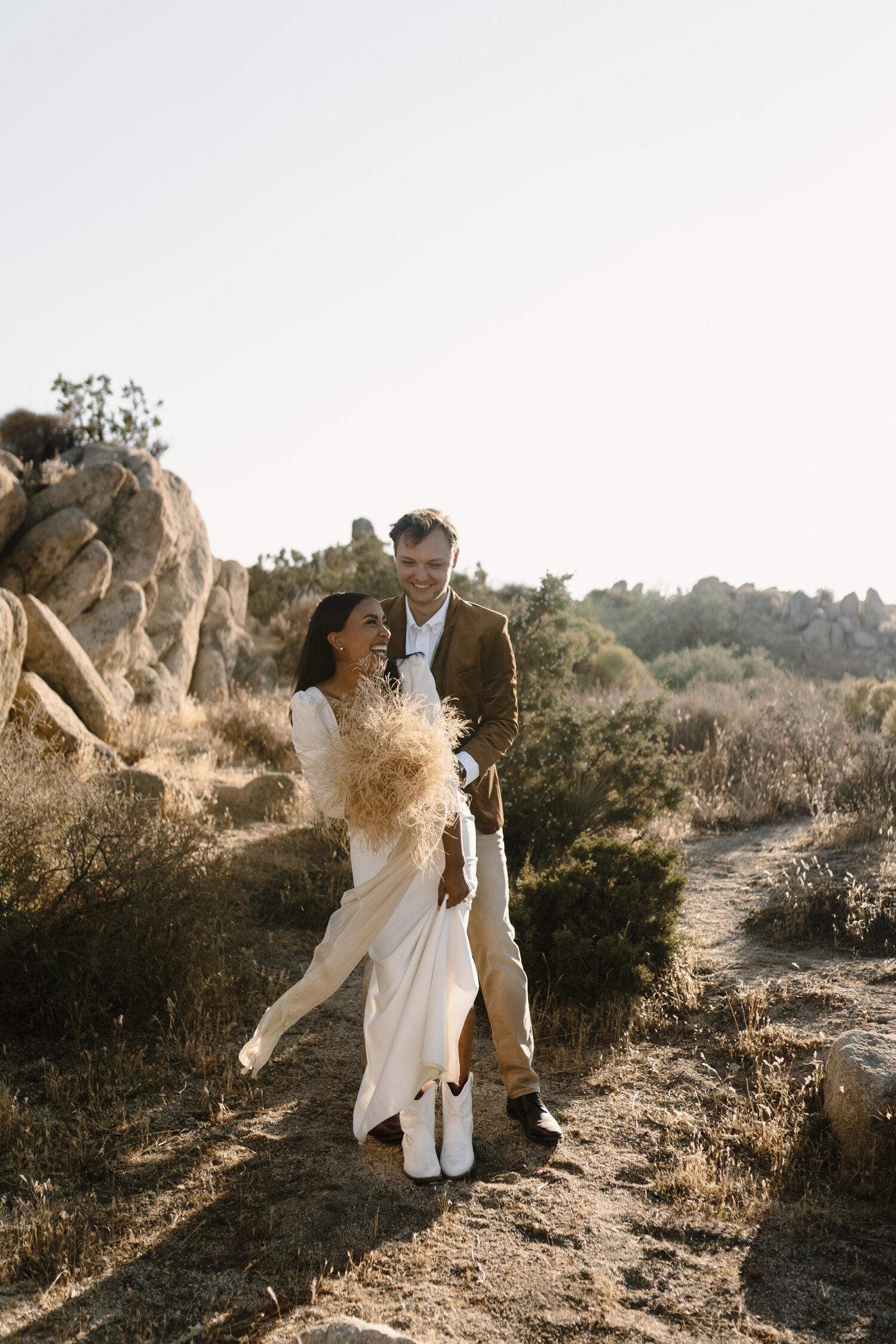 Playful bride and groom portraits by Kayli LaFon Photography
