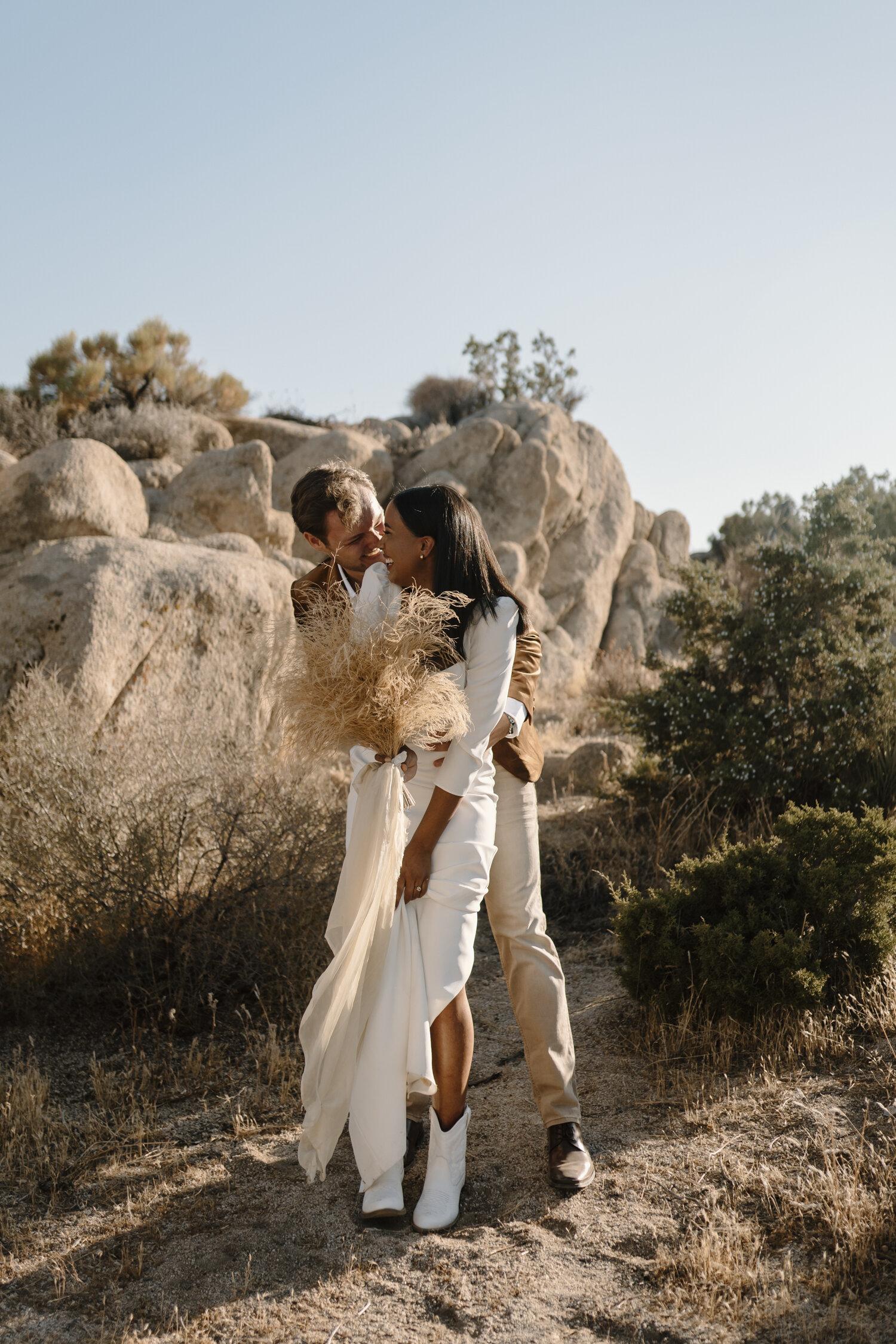 Playful bride and groom portraits by Kayli LaFon Photograhy