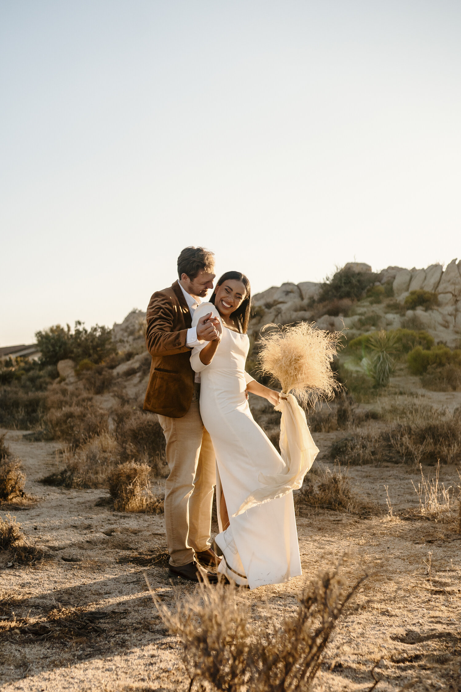 Fun bride and groom portraits at their romantic Joshua Tree Elopement | by Kayli LaFon Photography