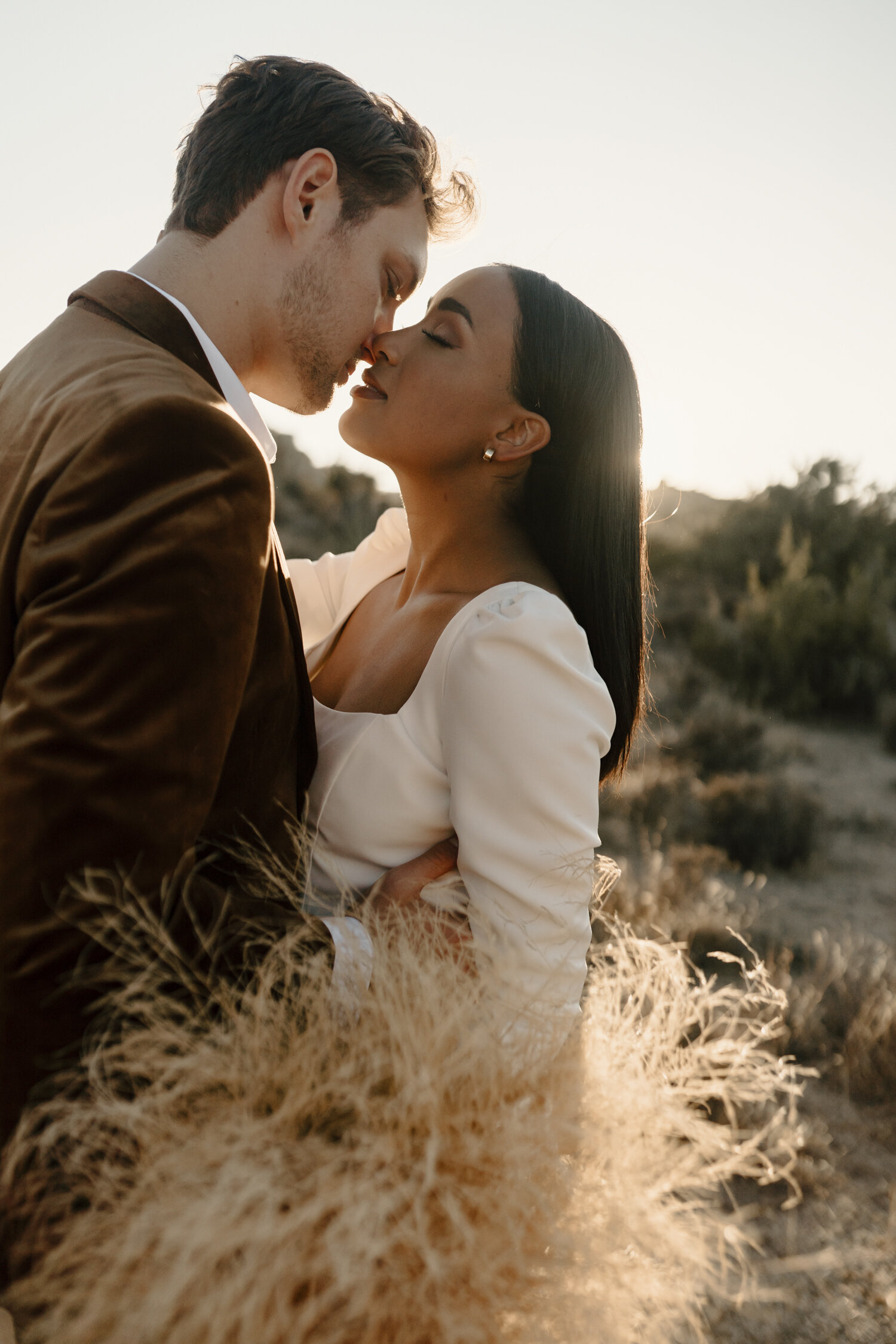 Super romantic golden hour bride and groom portraits in Joshua Tree by Kayli LaFon Photography