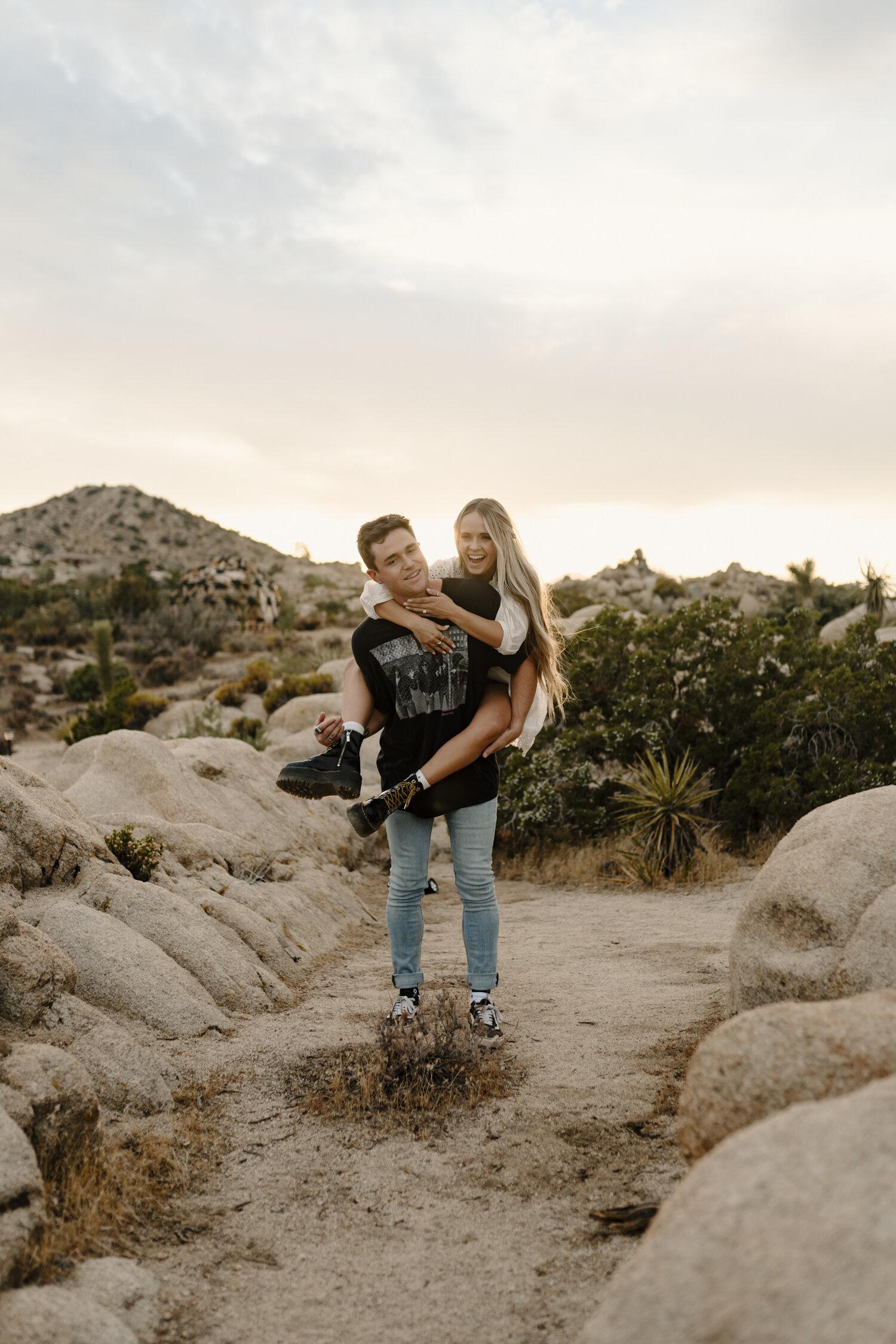 Joshua Tree, California golden hour engagement session, couple goofying off   by Kayli LaFon Photography