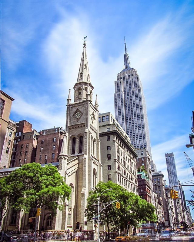 Icon of New York: Empire State building Looking North from where East becomes West on 29th Street, looming from 4 blocks down behind the Marble Collegiate Church; twice the tallest building in Manhattan, only trumped by the WTCs in 1970/2012