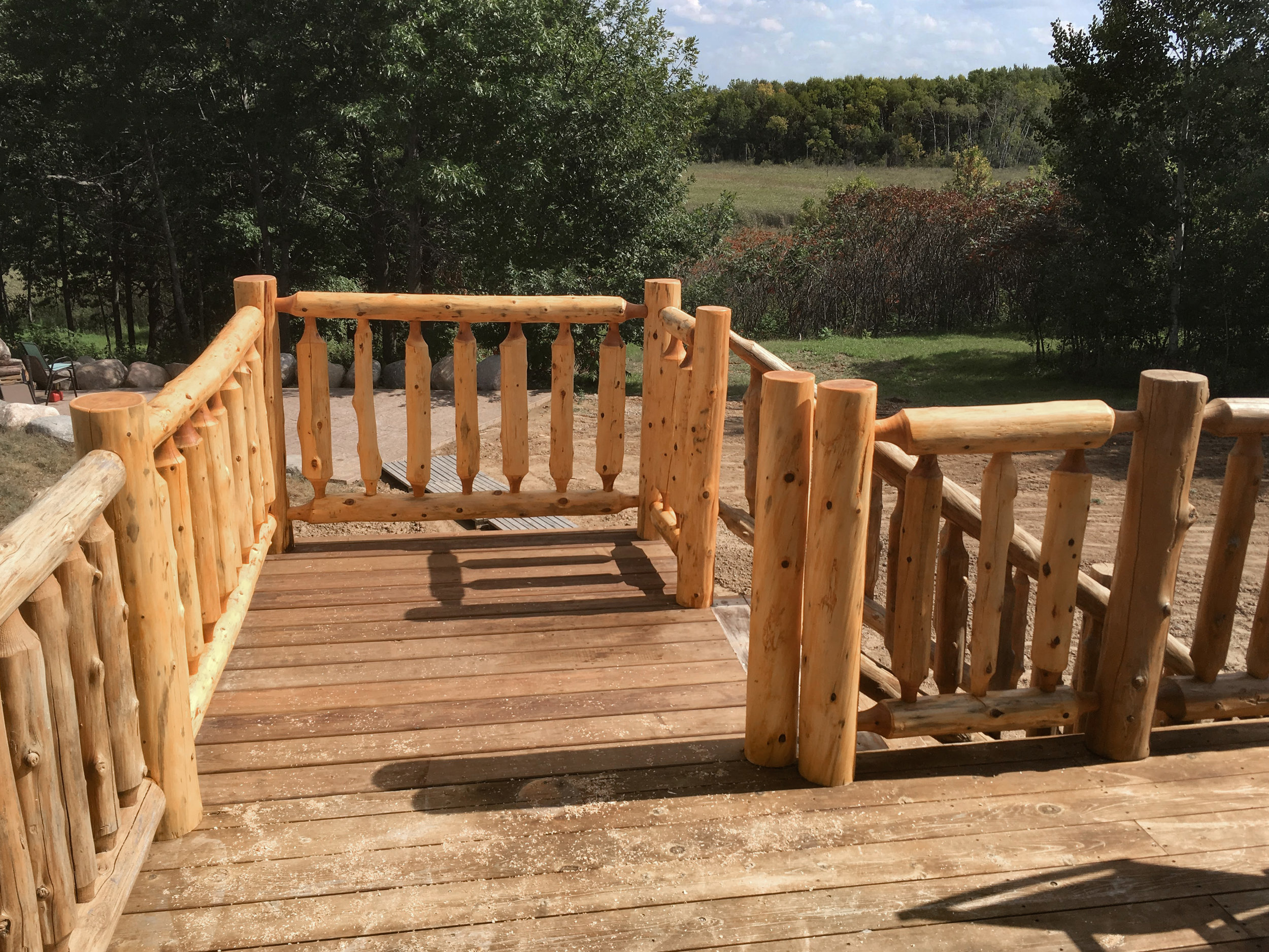 Cedar Spindle Log Railing by Soderlund's Wood Mill in Chisago City, Minnesota