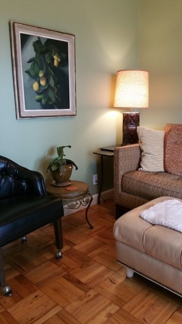 Sourced vintage mid-century black chair, side table and tiki style table lamp on Craigslist.