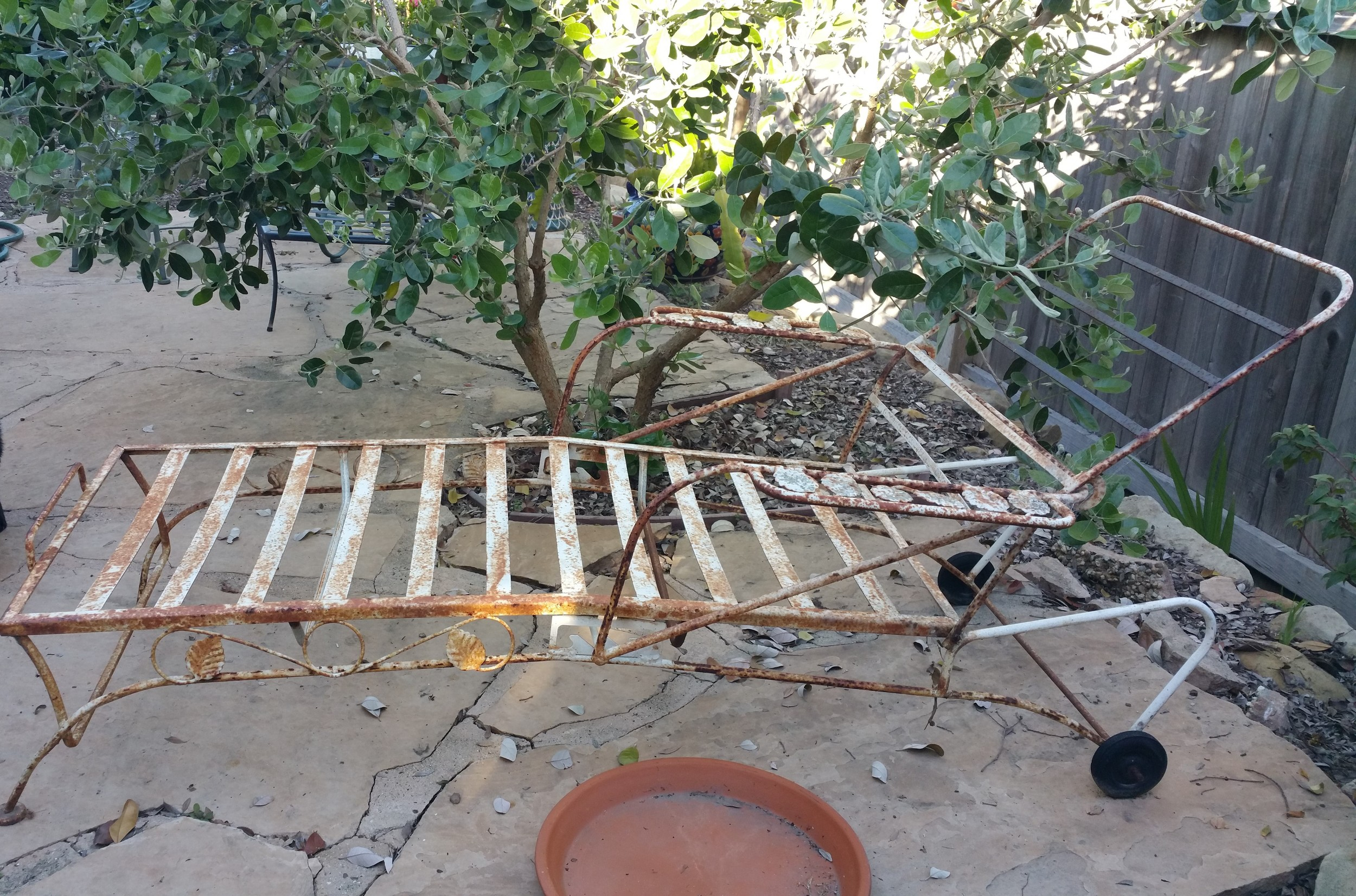 Before restoration. Vintage, circa 1950's, wrought iron lounger.