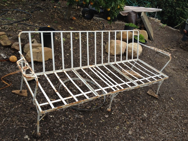 "Before restoration. Vintage, circa 1950's, wrought iron couch was found ""free""."