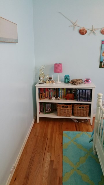 After redesign. Clear pathway to the bookcase.
