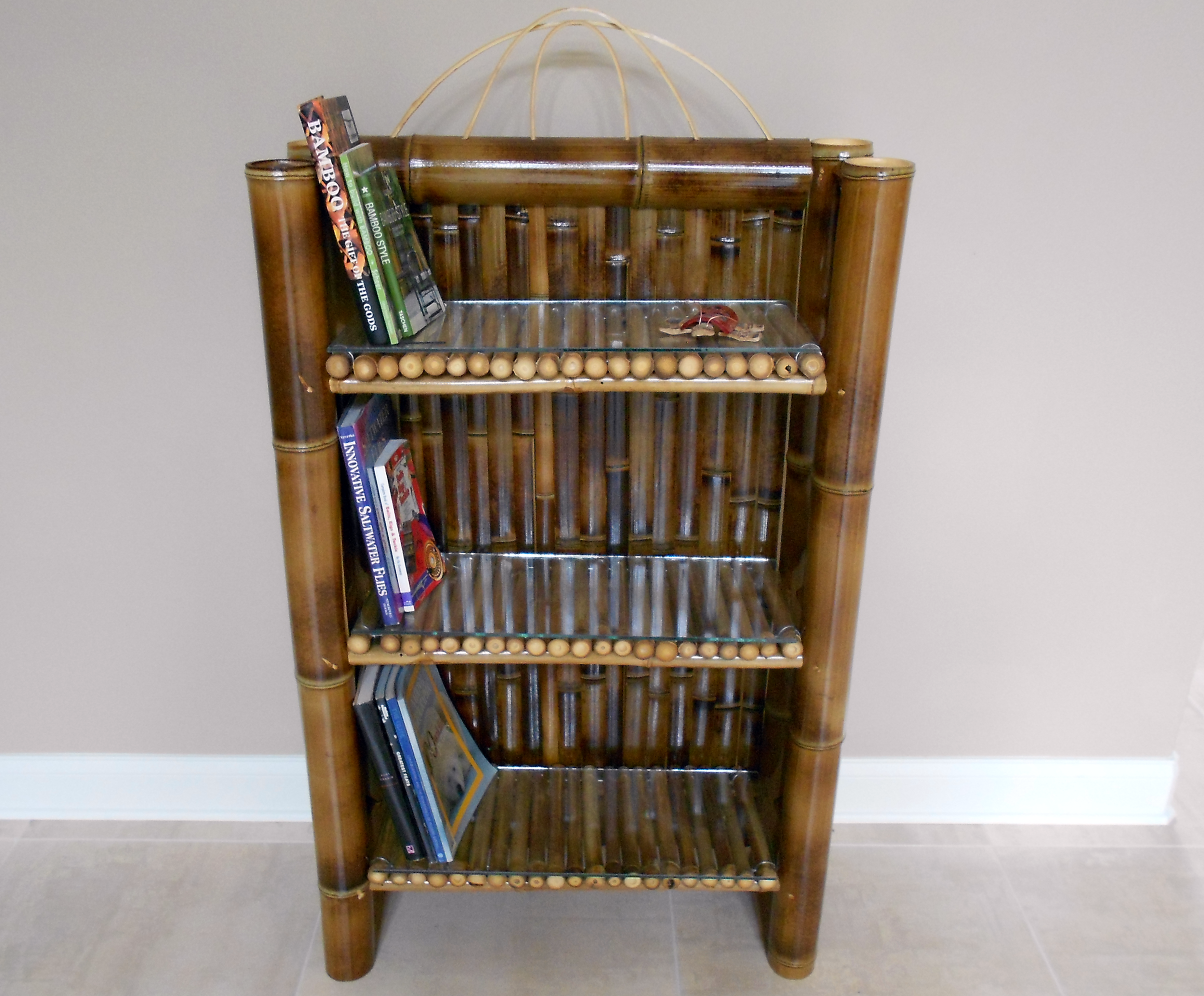dark bamboo bookcase with books.png