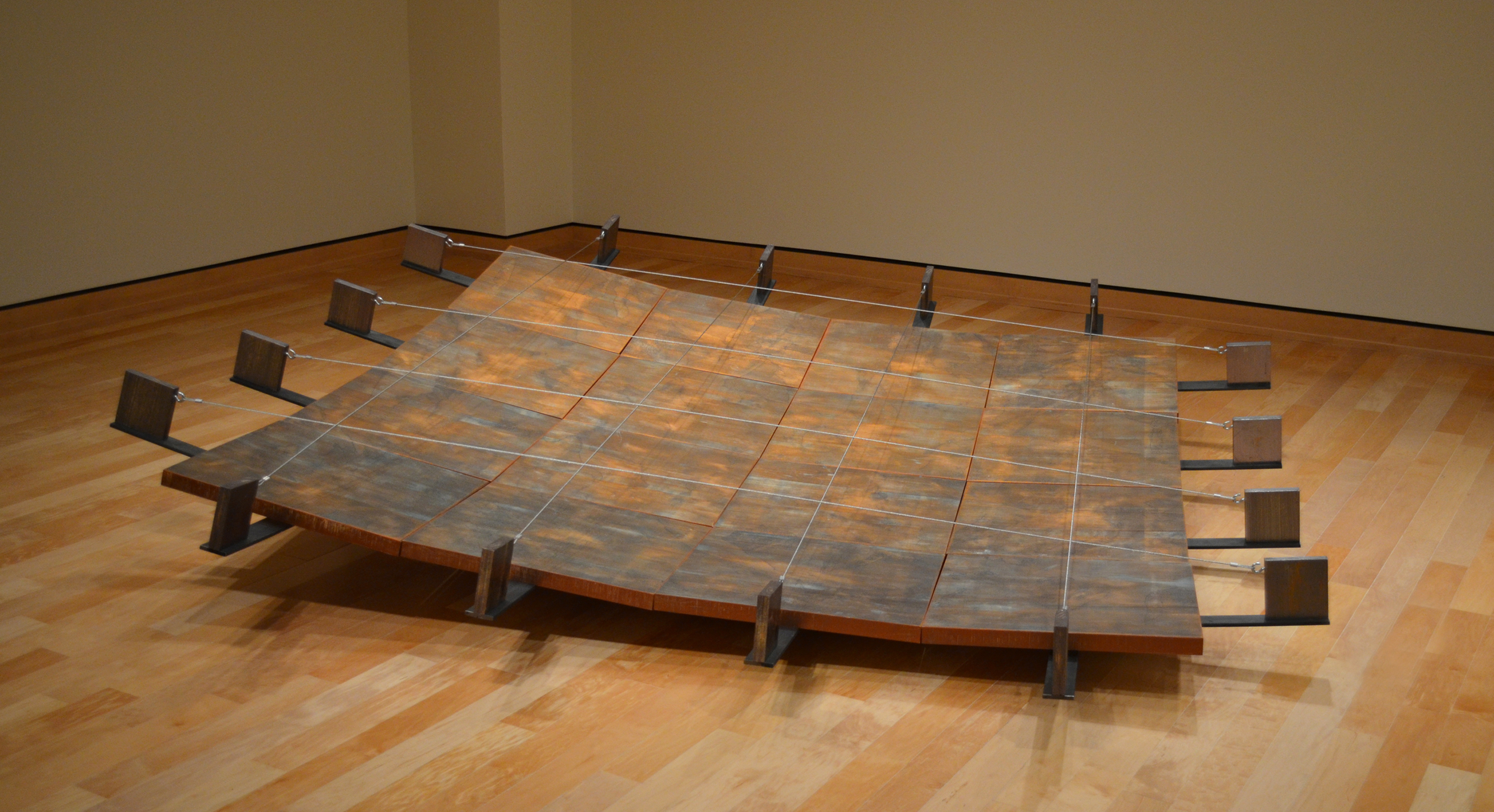"""Basin    woodcut printed images on paper, mounted on constructed panels, installed on a shallow bowl-shaped steel structure. ink, paper, metallic foil, wood, steel, cable 120"""" x 120"""" x 28""""   (10' x 10' x 28"""") 2012  I have been told by a select few that I am a closet ceramist.   I do love collecting ceramic art, both functional and sculptural.   The simple geometry of a shallow basin shape has interested me for some time now.   It is both functional (it can hold some material) and non-functional (it cannot hold a great deal of said material)."""
