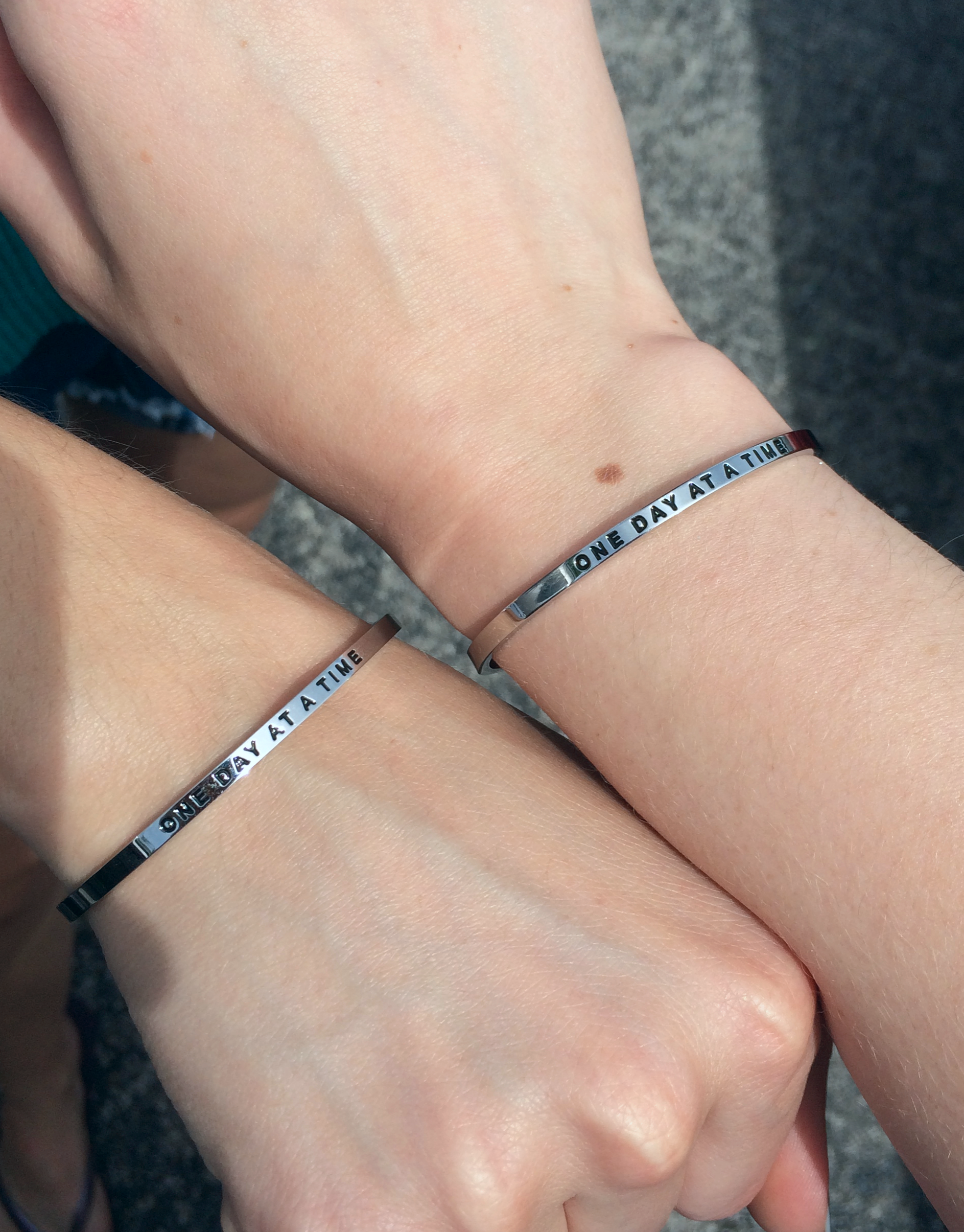 Showing off our matching  Mantra Bands .