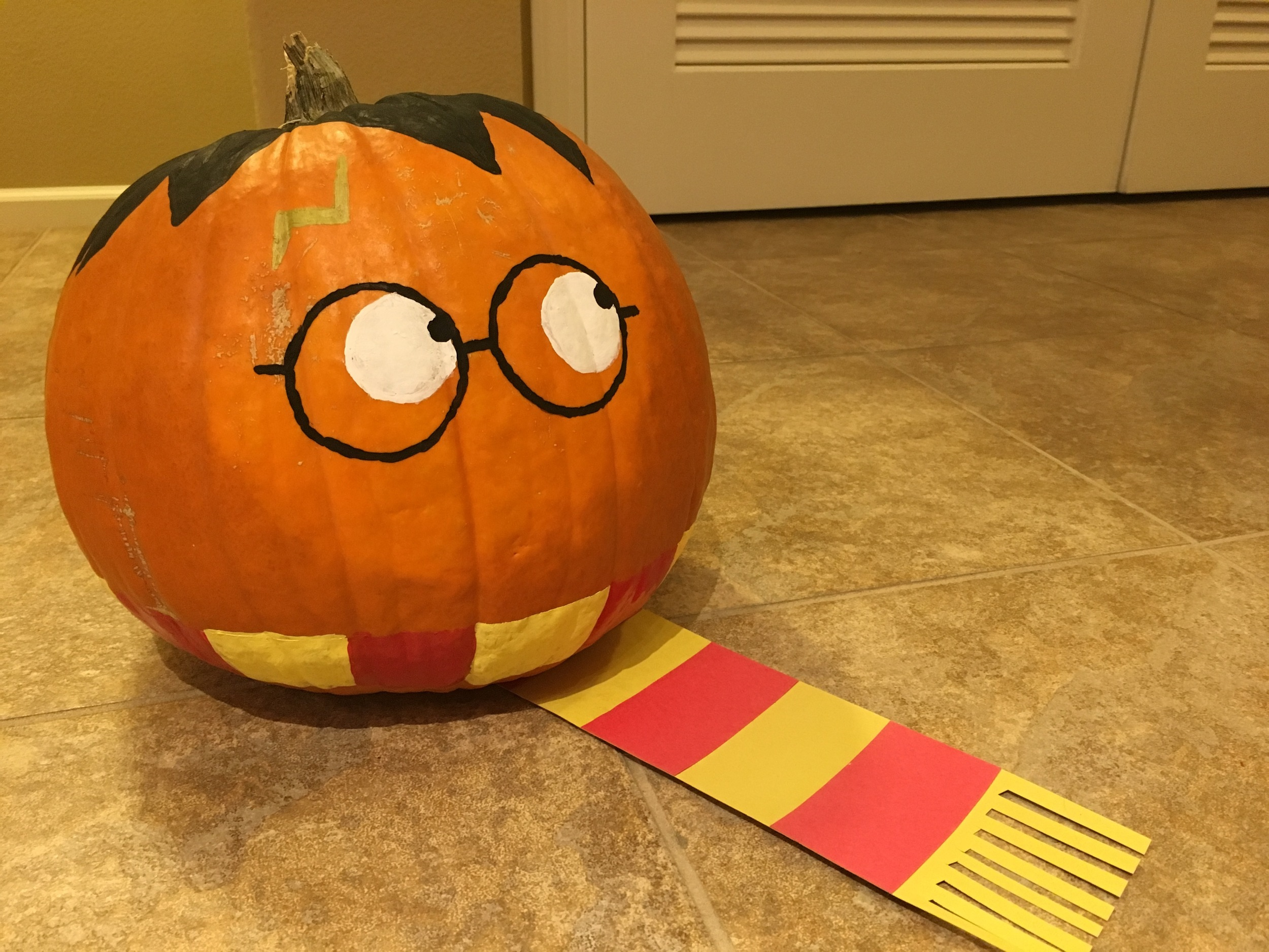 Lydia's spot on Harry Potter pumpkin, complete with his famous striped scarf!