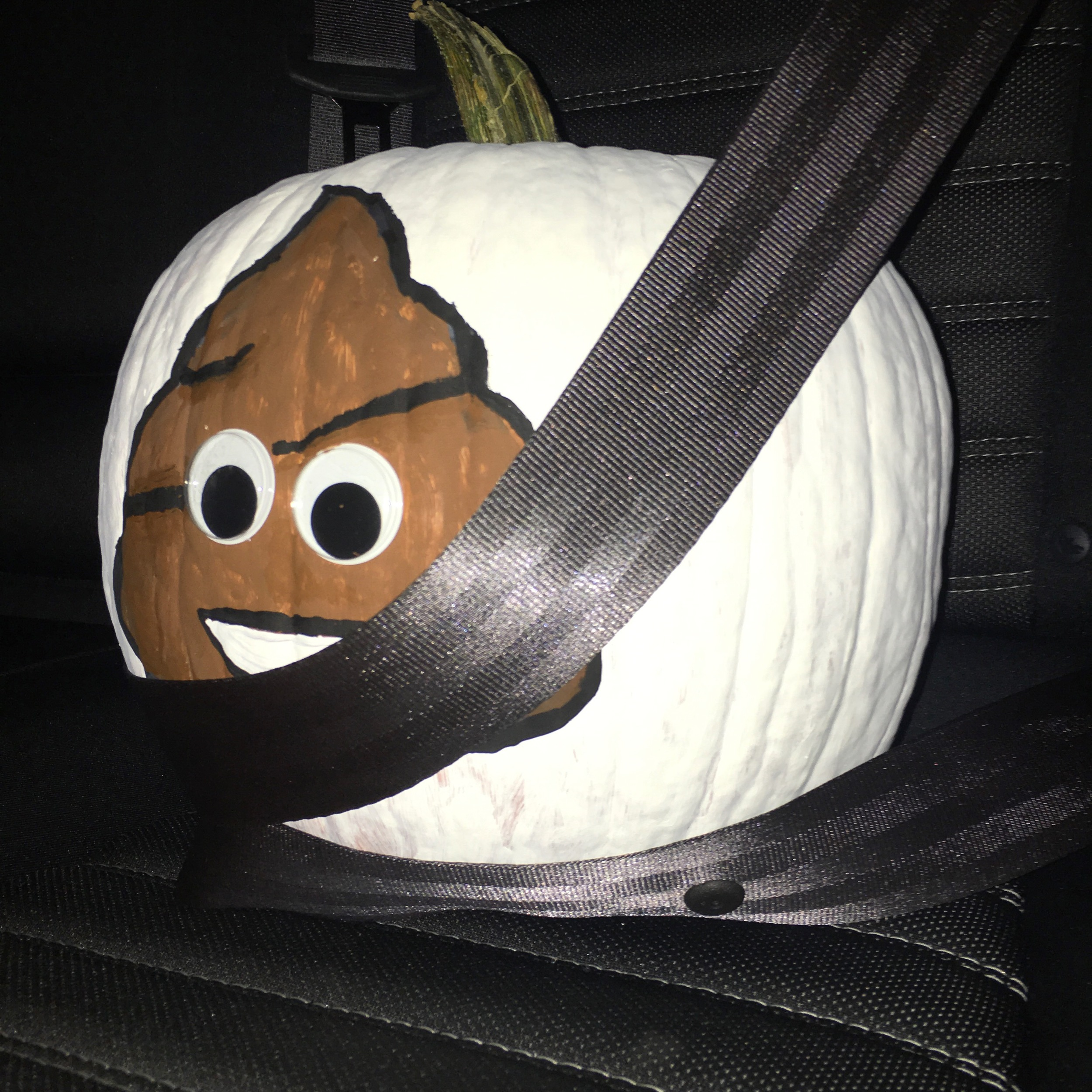 Safety first, especially when traveling home with your emoji painted pumpkin.