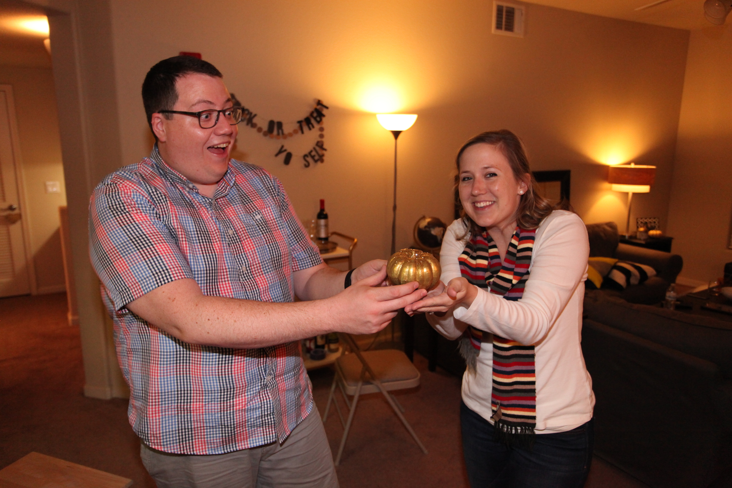 The winners of the crowdsourced voting sharing their golden trophy pumpkin!