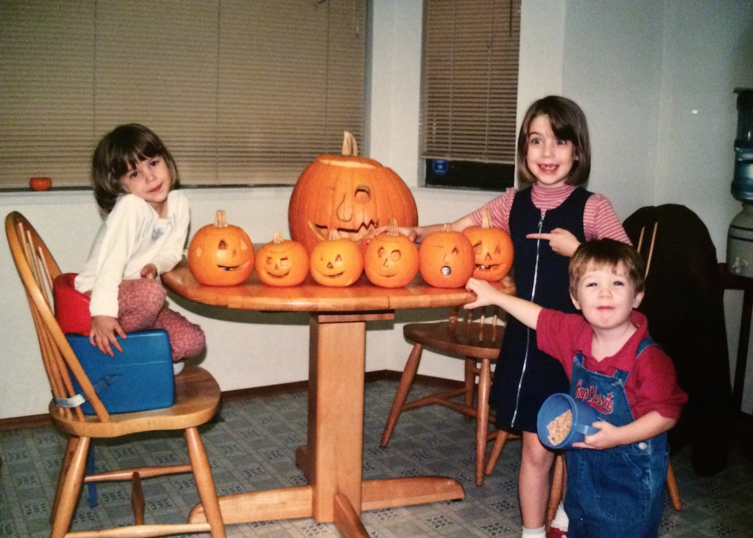 Me, being WAY too excited about our jack-o-lanterns, with my sister Melissa and brother Richard. p.s. I loved that zip up jumper/ mock turtle combo I was wearing.