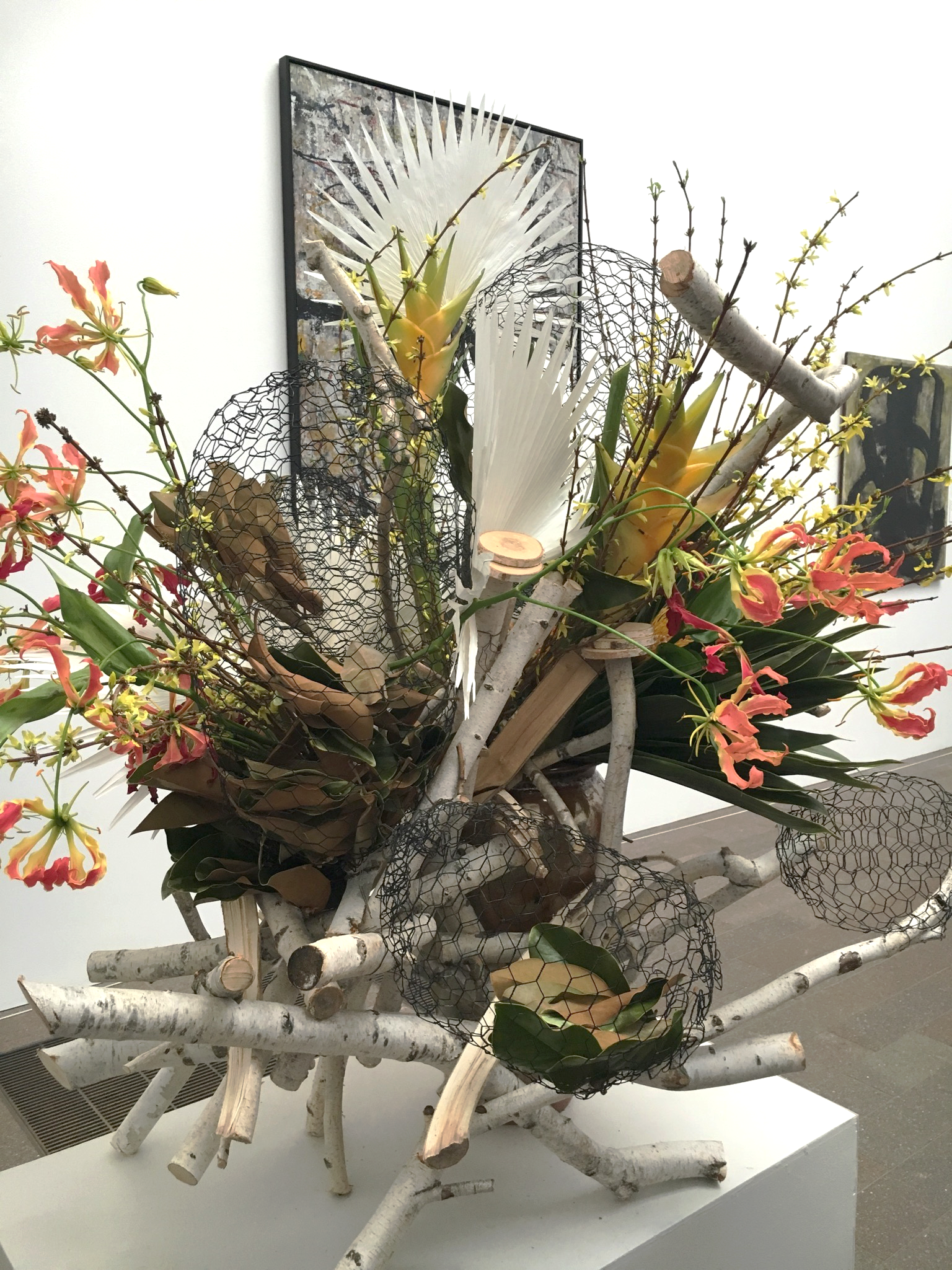 I didn't even get the original piece of art into the photo, but the floral arrangement in and of itself is inspirational. What a crazy dynamic structure.