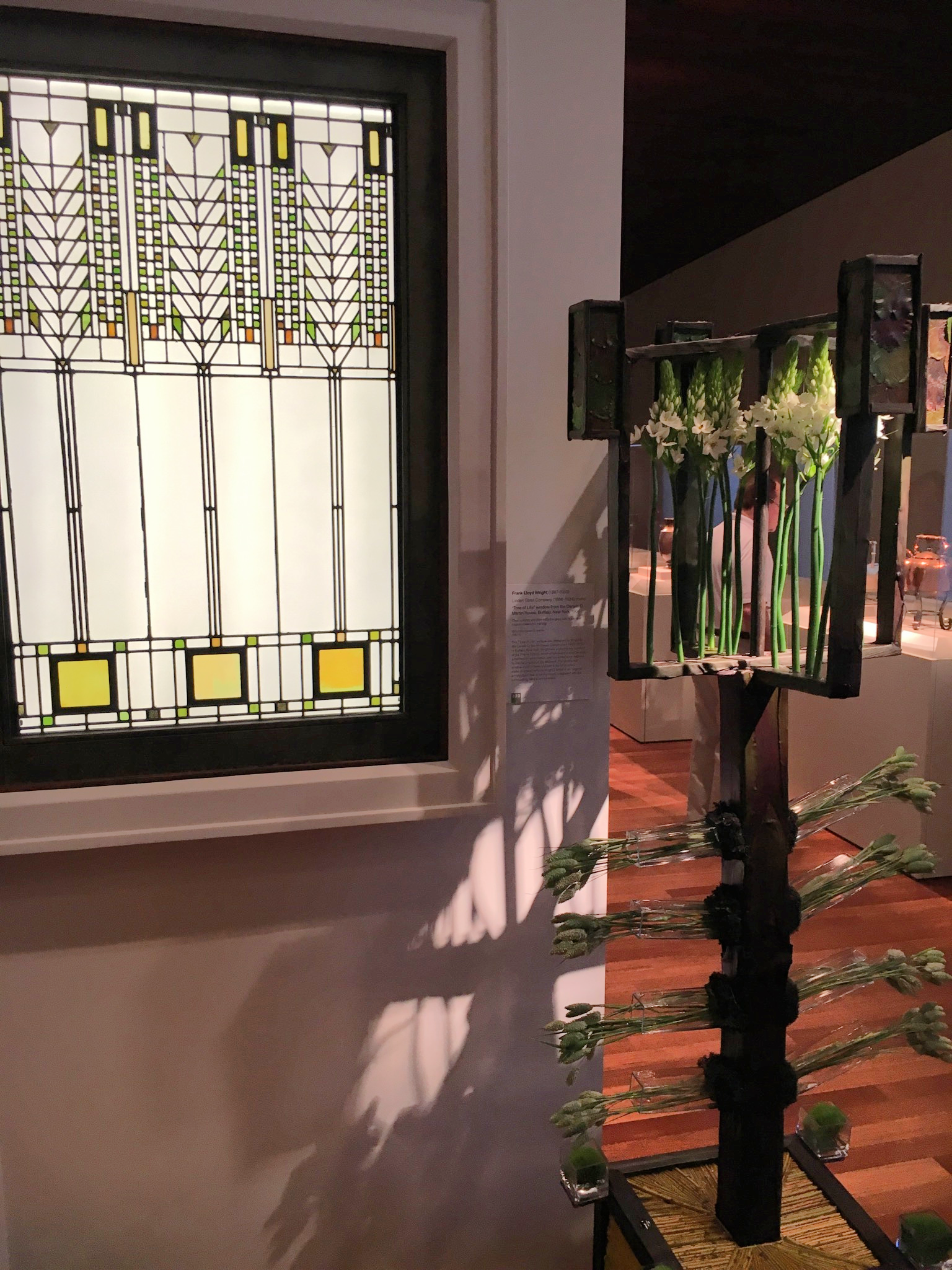 My Mom and I liked this combo of art and floral arrangement, and then we realized the stain glass is Frank Lloyd Wright!