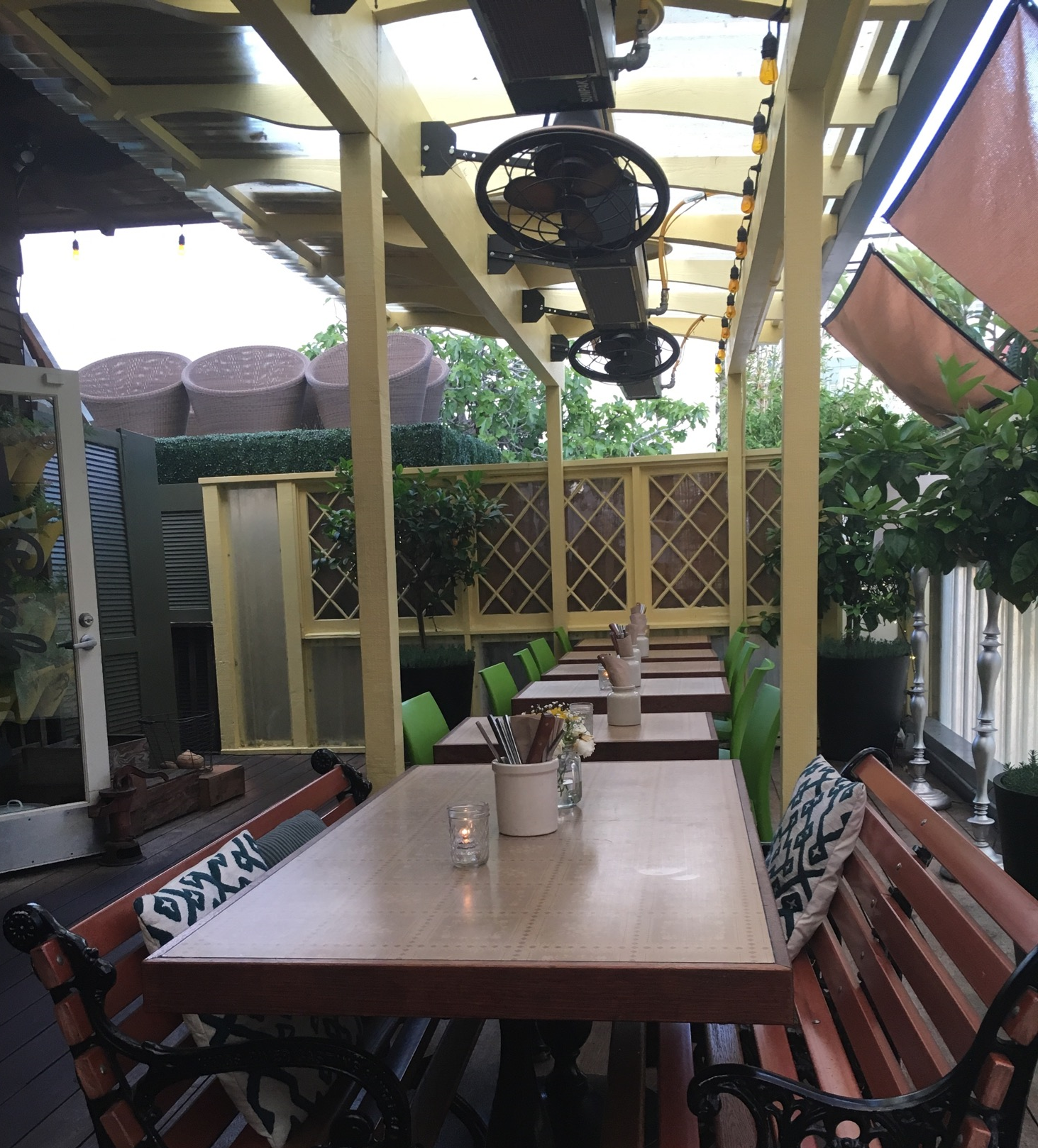 A portion of the patio at Queenstown with heaters  and  fans depending on the weather. Perfect for San Diego.