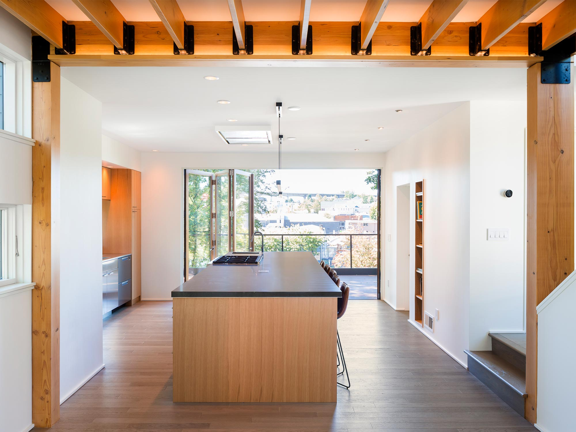 The sunset-facing deck serves as an extension of the open living area.