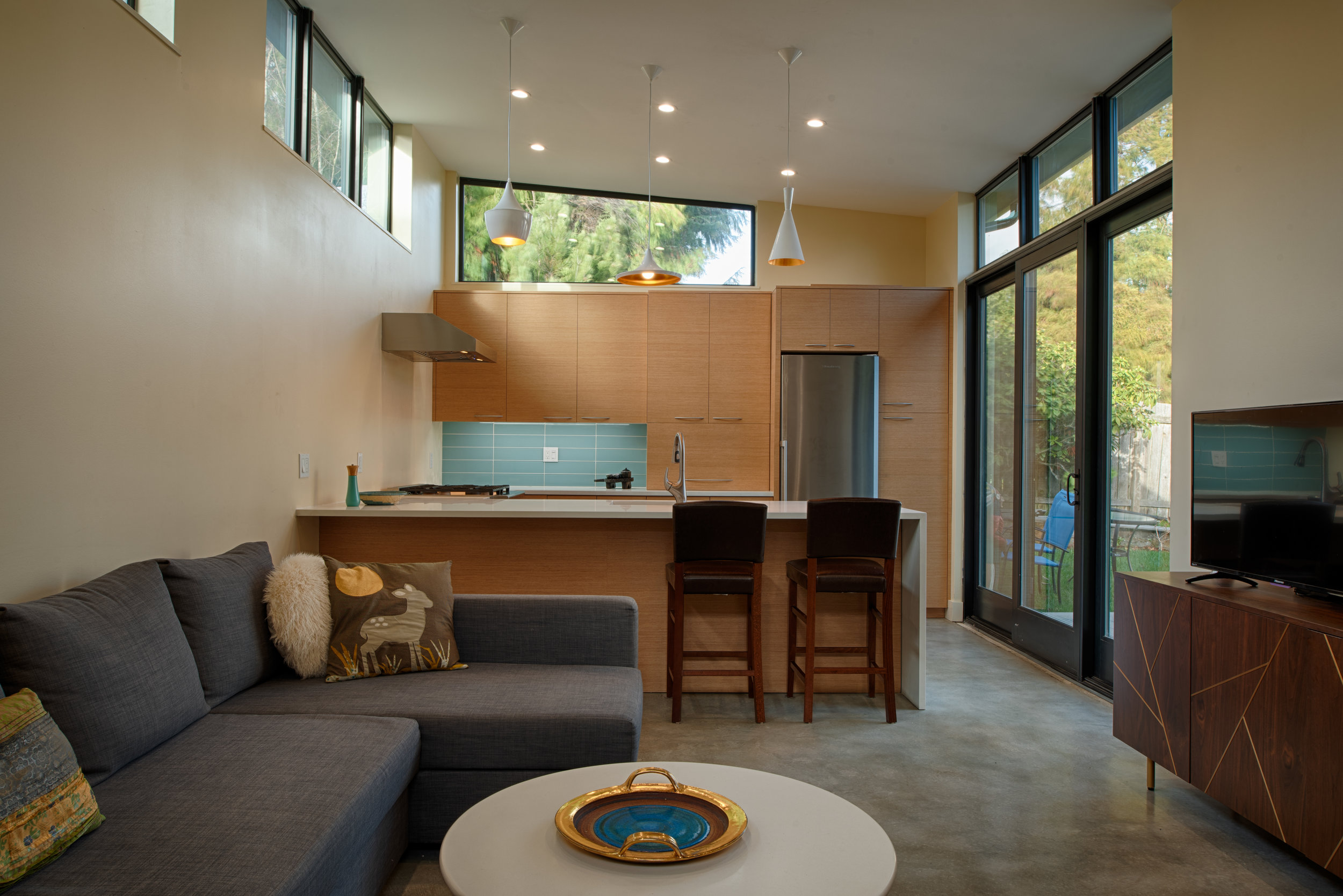 A single story detached accessory dwelling unit designed to allow a retired couple age in place while sharing a property with their children and grandchildren.