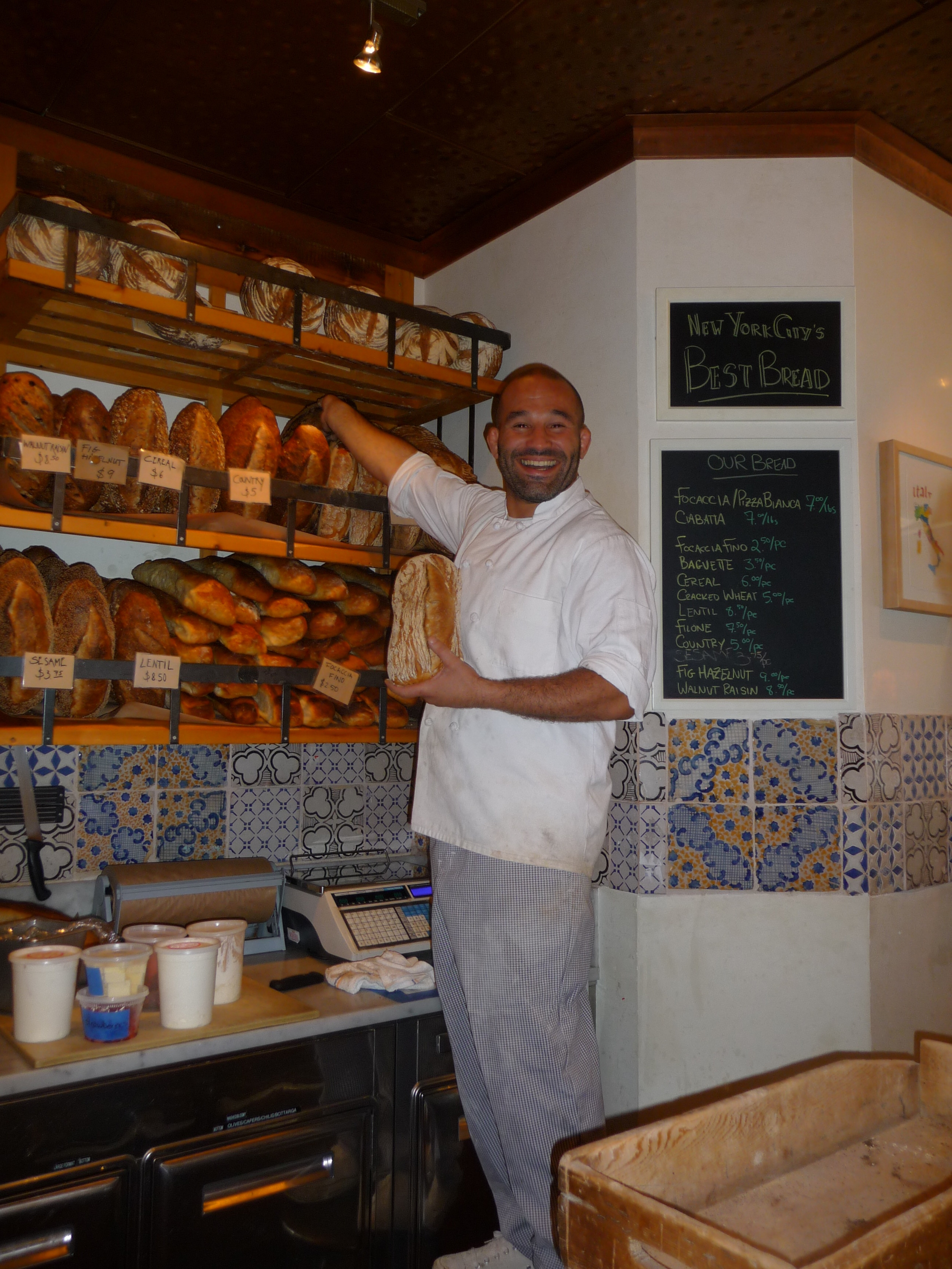 Kamel Saci shelving his freshly baked bread