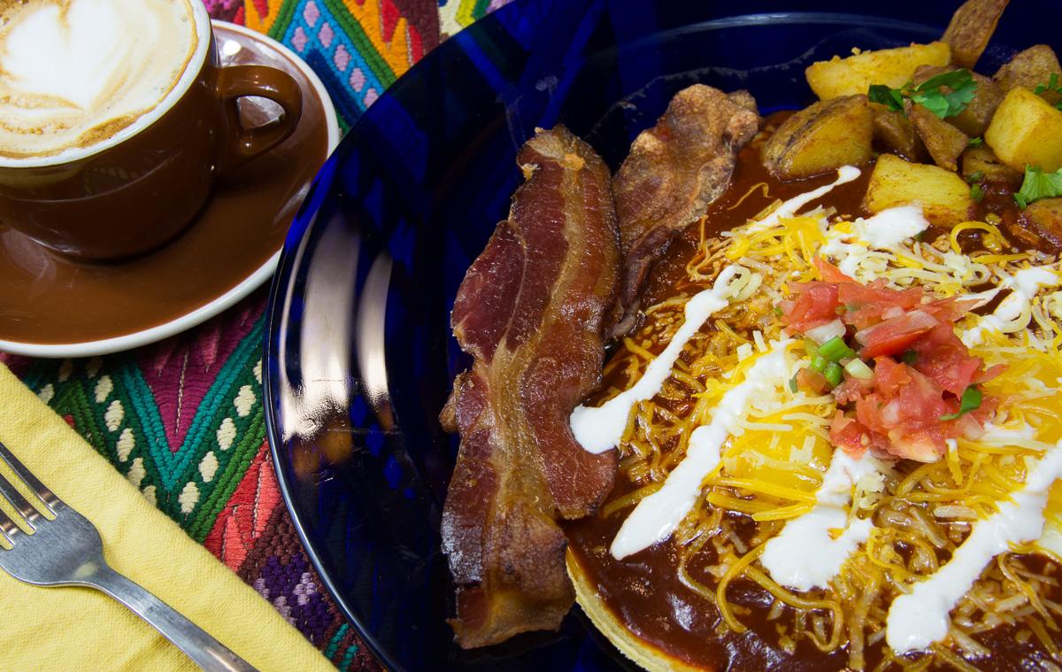 Huevos Rancheros, red sauce, side bacon and a cappucino