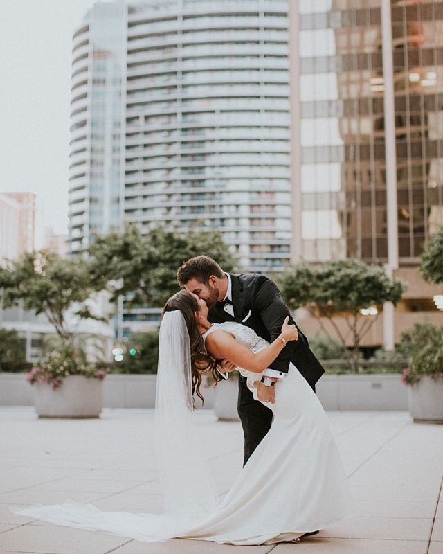 "We love capturing a few ""just married"" photos after the ceremony! Even if you had a first look, there is just something about finally being pronounced as husband and wife for the first time that makes you feel ontop of the world. Love these two! ❤️❤️ Sidenote: Le Meridian's roof top is amazing and offers some of the best 360 views of the city in Arlington VA. Also if you haven't checked out Jimmy & Lauren's wedding blog on our website yet, you should do so now. 😉"