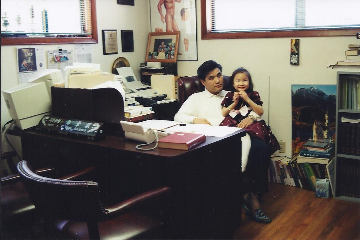 First Clinic - My wife took this photo of me and my daughter, Grace, at my old office.
