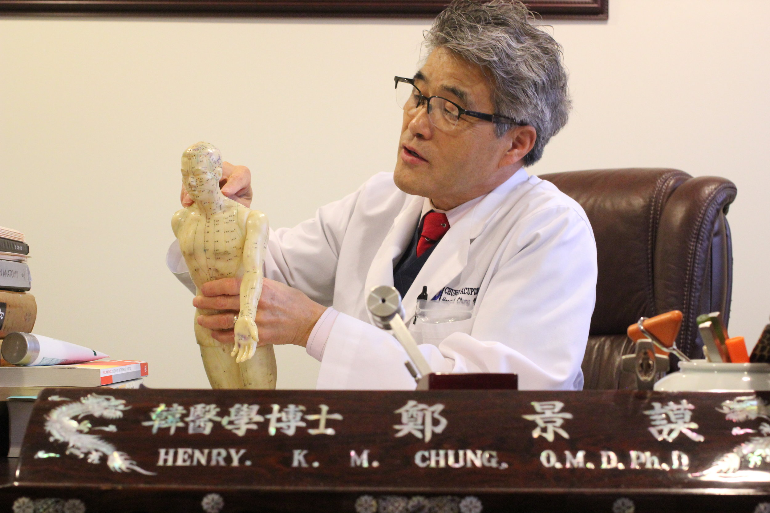 Dr. Chung licensed acupuncture professional explaining his treatment plan to patient