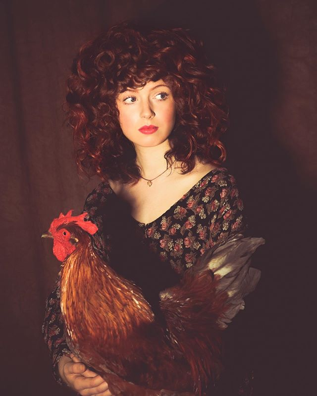 A girl and her chicken. ⠀⠀ Not oil on canvas ⠀⠀ #surrealphotography by @auroraandjohn ⠀⠀ Model: @riley.pinkerton Hair by @harliquin_ / @privatepractice.nyc Styling by @lunalaulu  Chicken from @acmebrooklyn