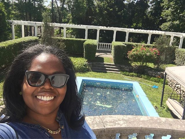 """This is me... looking out at Madam C.J. Walker's pool. Yes, that Madam C.J. Walker, the first """"African American Millionairess""""! I must write a blog post about this experience. Coming soon!! ✊🏾❤️ . . #madamecjwalker #madamcjwalker #blackexcellence #irvingtonny #tevtravels"""