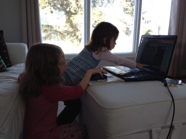 My oldest helping her little sister with the interactive episode