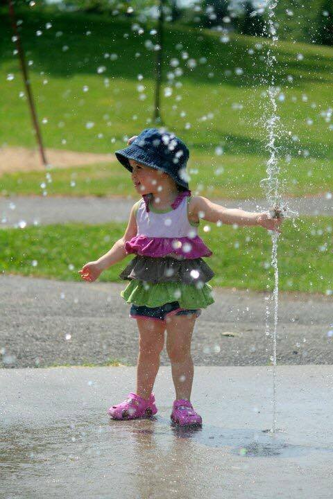 Toddler at a splash pad
