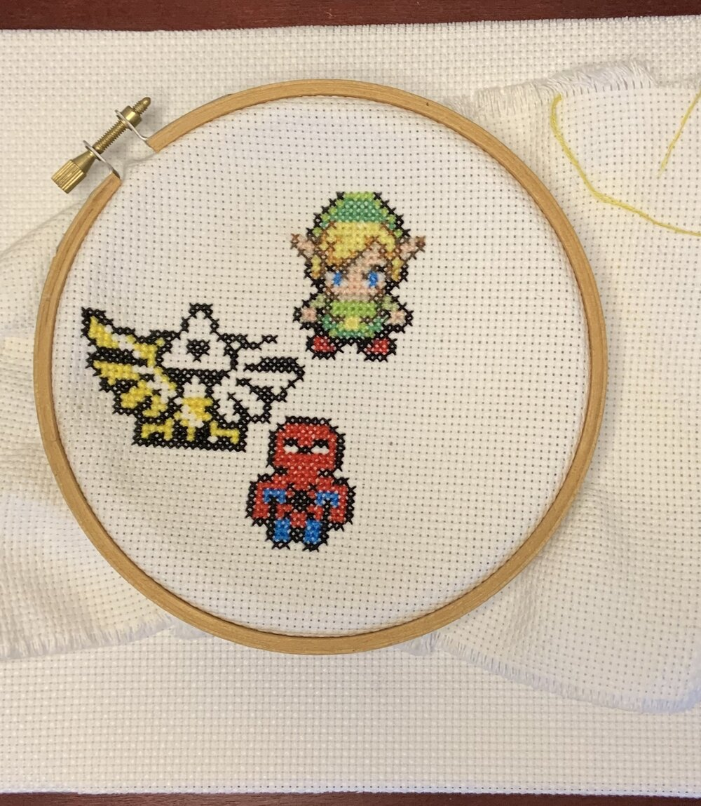 Cross stitch of various video game characters and symbols