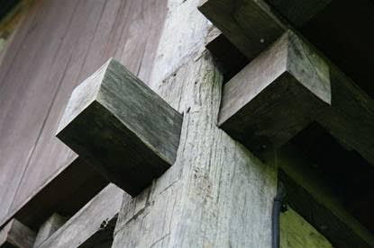 Two story Ulin post and beam construction showing mortise join which weakens the wood structure - a big fat no-no