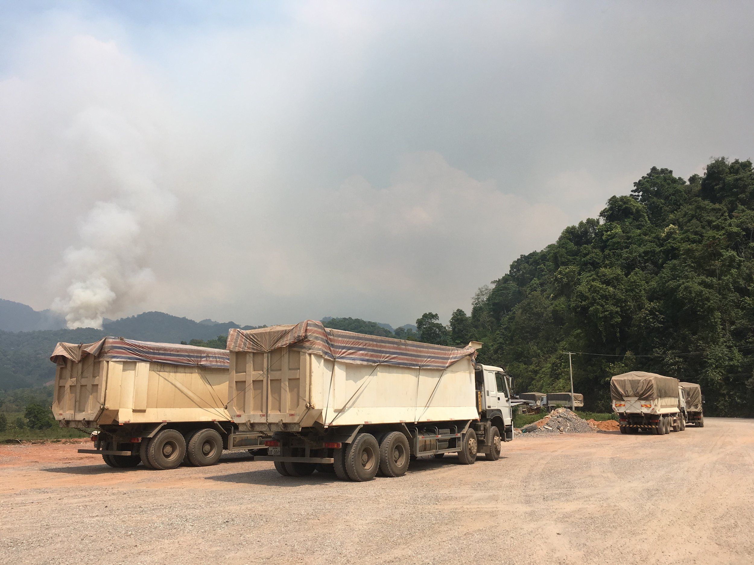 Trucks in northern Laos clear the way for the future.