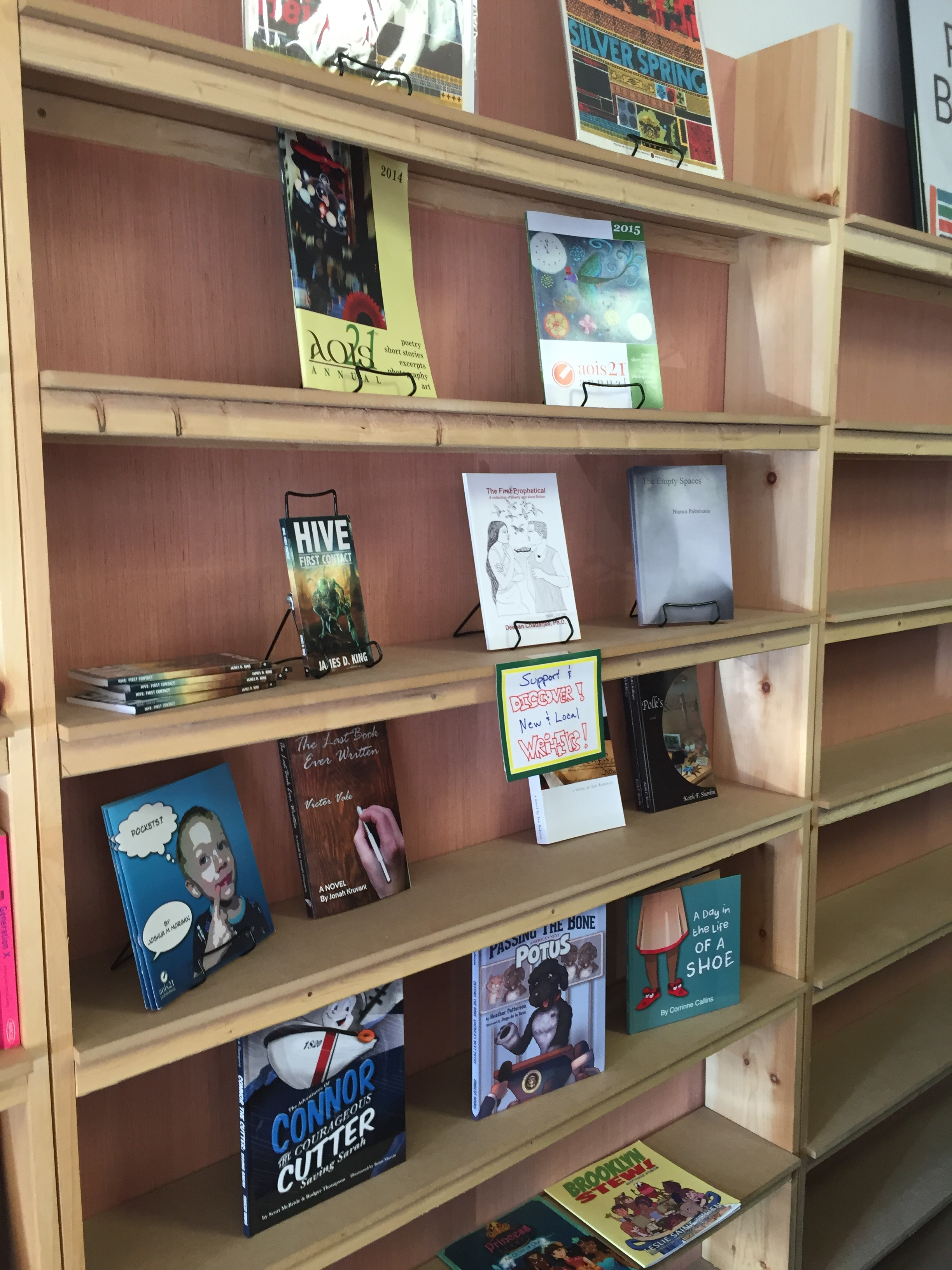 aois21 titles on the local author shelves at Walls of Books