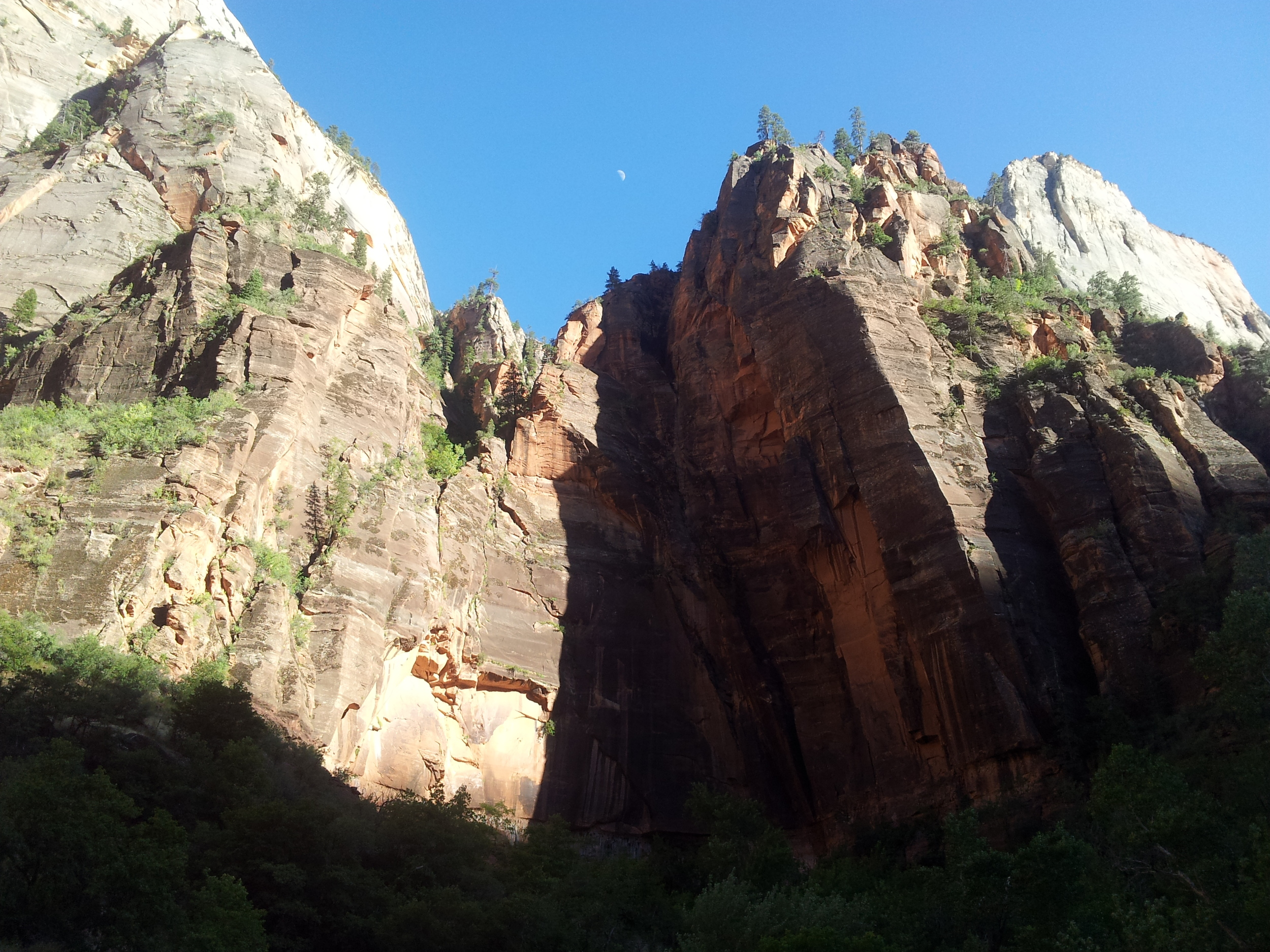 Looking up, Hidden Canyon is somewhere in a crevice up there