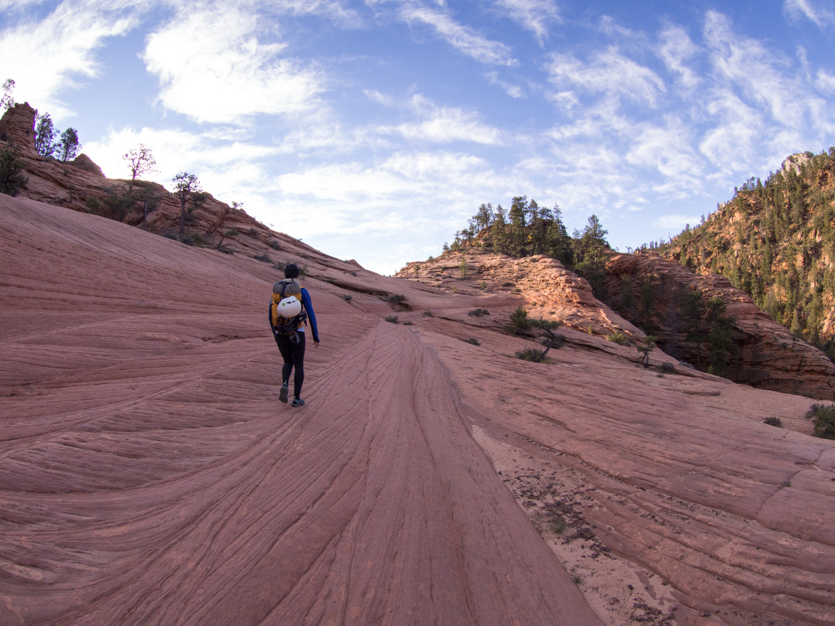 You cross a variety of terrains including this red slickrock