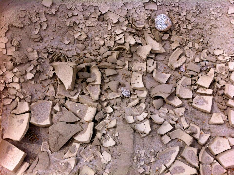 Dried mud shards that crunched under our boots