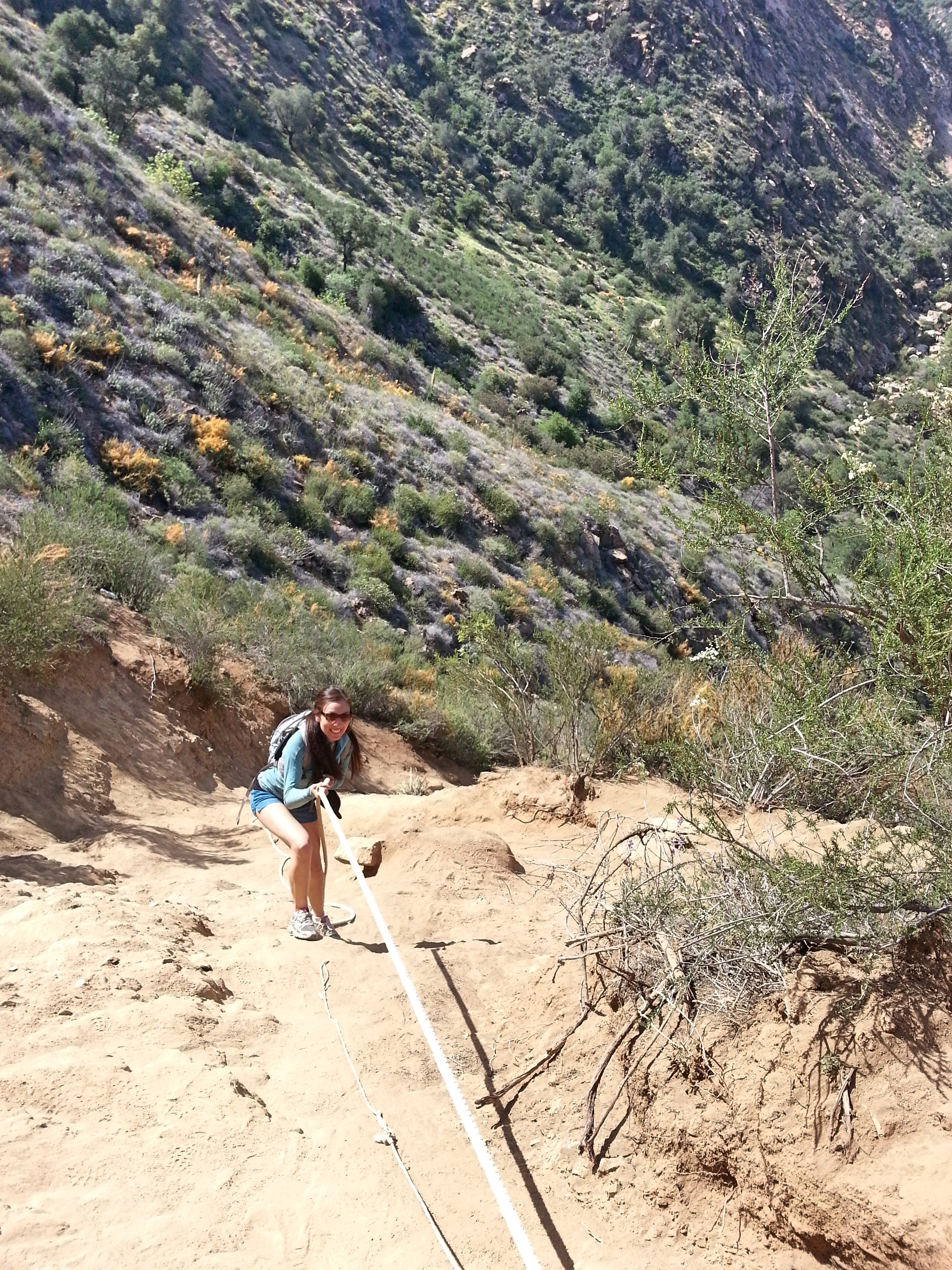 Vanessa using the rope to climb down the steepest section of the trail
