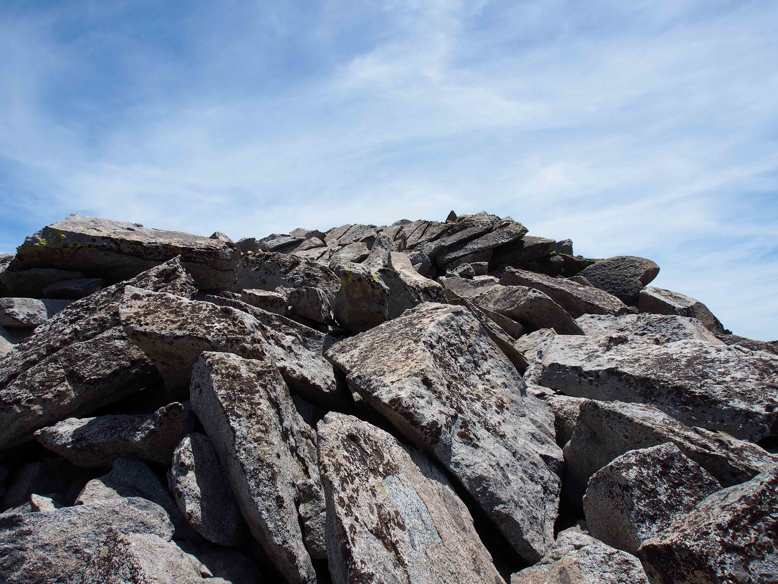 The final climb over boulders to the peak