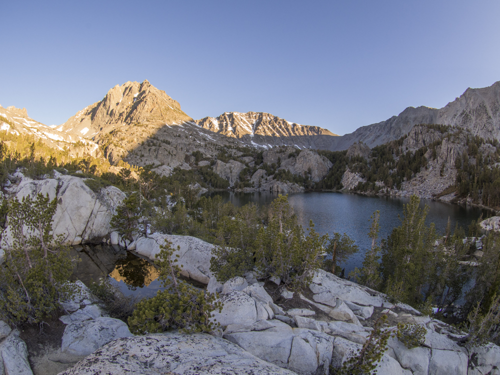 A pool of stagnant water on top of a rock pile near a large campsite. Photo by: Kyle McBurnie