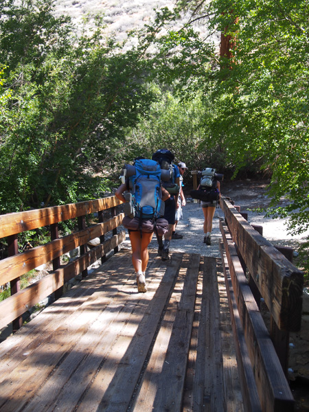 Crossing the wooden bridge and reaching a junction