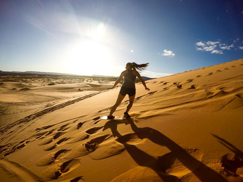 Elaine boarding down the sand mountain