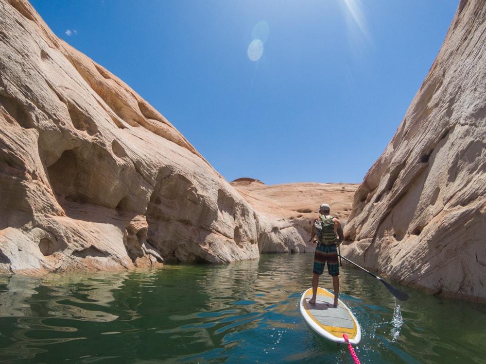 Stand up paddleboarding to Lake Powell slot canyon