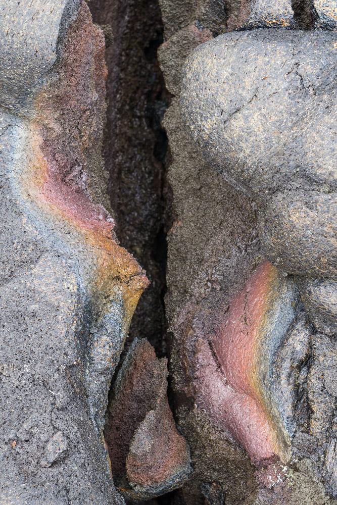 Rainbow colors on cooled volcanic rocks
