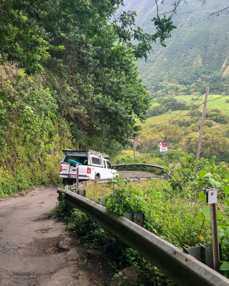 A truck driving down the steep road