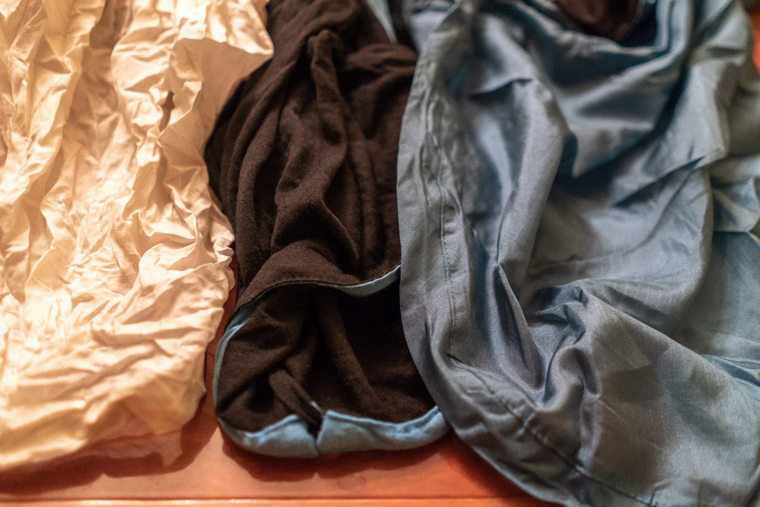 Comparing the different fabrics of the liners. From left to right:  Cocoon Silk Mummy Liner ,  Sea to Summit Thermolite Reactor Liner ,  Sea to Summit Premium Silk Liner .