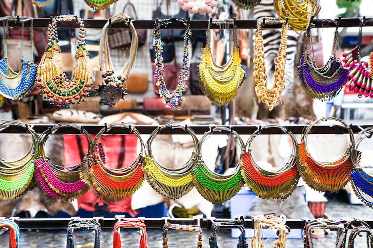 Colorful necklaces line a stall at Greenmarket Square